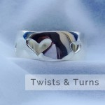twists and turns, artist directory, pass the feather