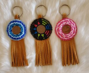Beth Queau, crafts, beadwork, feathers, medicine bags, jewelry, pop sockets, keychains, purses, Indigenous Artist, First Nations, Indigenous Arts Collective of Canada, Pass The Feather